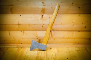 Rustic ax in the sauna. decorative wooden boards