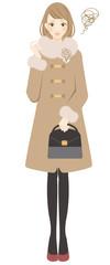 コートを着た女性 怒る