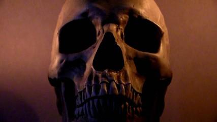 Human skull in flickering candle light