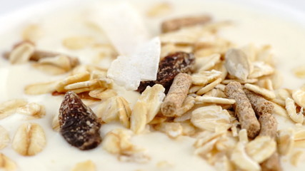 Smooth low-fat yogurt oats, muesli rotating in slow motion