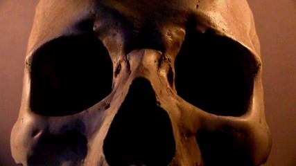 Human skull in flickering candle light