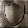 old metal shield over armor background - 74664332