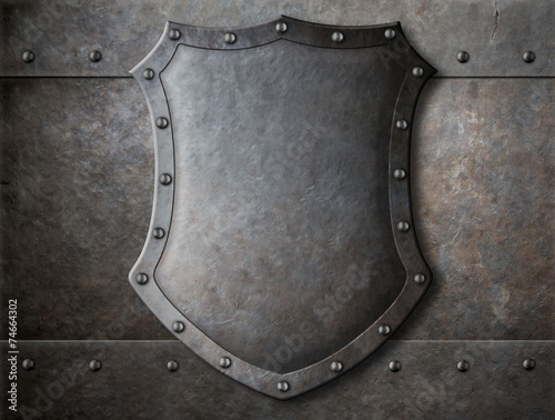 old medieval coat of arms shield over armour background
