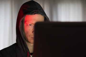 Male with criminal intentions at a computer on the internet.