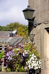 Hanging basket and wrought iron lantern, Buxton