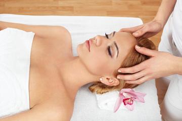 Beautiful young woman having massage