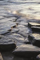 Beautfiul vibrant sunset over Kimmeridge Bay Jurassic Coast Engl