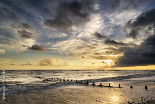 Beautiful vibrant seascape at sunset image with dramatic sky and © veneratio