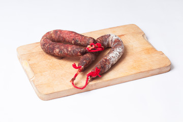 Two spanish chorizos over a table kitchen.