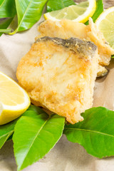 Piece of cod fried on lemon leaf