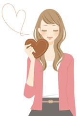 ハート型のチョコを持った女性 笑顔