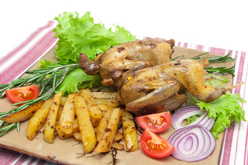 appetizing carcass woodcock with vegetables on a plate close-up