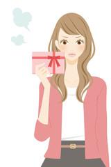 プレゼントを持った女性 怒る