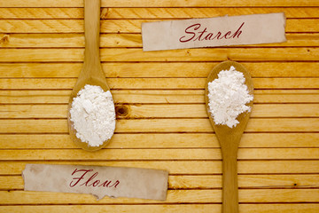 Wooden spoon with flour and starch