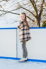 Cute little girl on skating rink