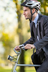 young businessman wearing bike helmet