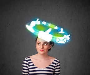 Young teenager with cloud social icons around her head