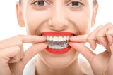 Fototapety Wearing orthodontic silicone trainer