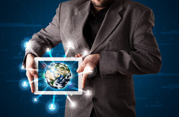 Businessman presenting 3d earth globe in tablet