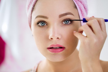 Close up of woman applying mascara