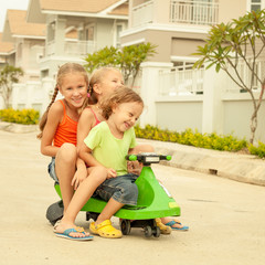 happy children playing on the road at the day time