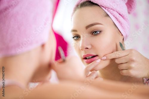teen girl having pimple - 74674709