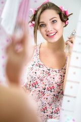 beautiful girl applying perfume