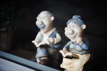 Smiling Grandparents reading book