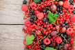 Fresh ripe berries on wooden table