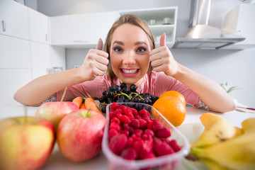 Young girl with lot of fruits