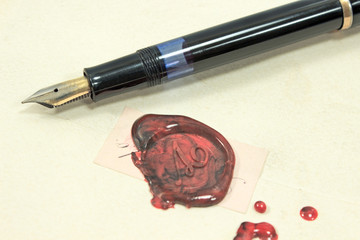 Fountain pen and wax sealed letter
