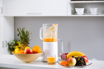 Prepared smoothies and healthy smoothie ingredients in blender w