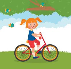 Joyful child rides a bike