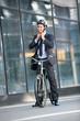 Businessman puts the bicycle helmet on head