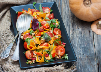 salad with marinated pumpkin, lettuce and cherry tomatoes