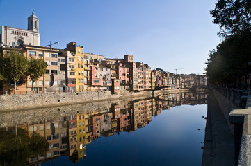 View Girona city  with colorful houses reflected in water of ony