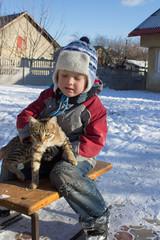 boy sitting on sled