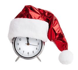 Santaklaus cap on a round alarm clock