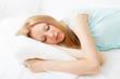 girl in nightshirt sleeping on white sheet