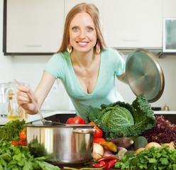 Pretty girly preparing soup