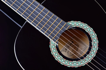 Close-up of an acoustic guitar body