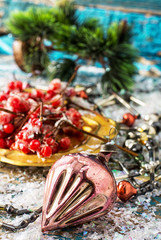 Christmas decorations with viburnum,strewn with snow on the dish