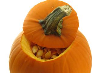 Small orange pumpkin with seeds