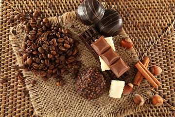 Pile of coffee beans with chocolate, nuts and cinnamon