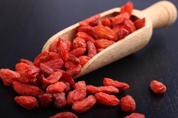 Goji berries in wooden scoop, one of the superfoods