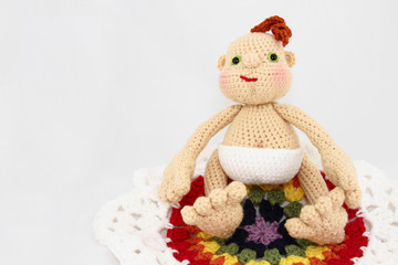 – HandCrafted Crochet Baby Doll On Colorful Blanket