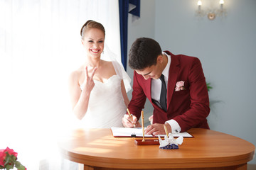 bride and groom signature in the registry office