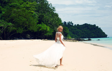 bride in wedding dress posing on beautiful island in Thailand