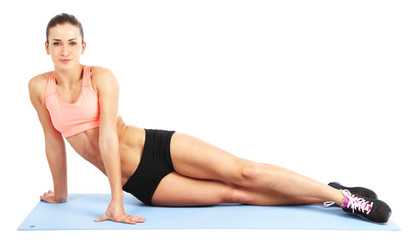 Fit woman doing exercise - isolated over white background