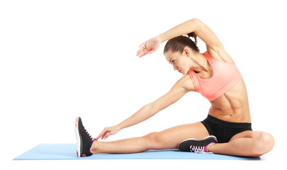 Fit woman stretching to warm up - isolated over white background